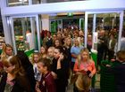 HUNDREDS of people gathered inside the Cabarita Woolworths shopping complex this morning, each hoping to be the first customer through the doors.