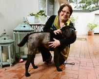 Janet Pisasale with her dog Sammy that survived after impaling itself on a fence.