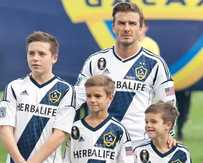 David Beckham with Brooklyn, Romeo and Cruz.