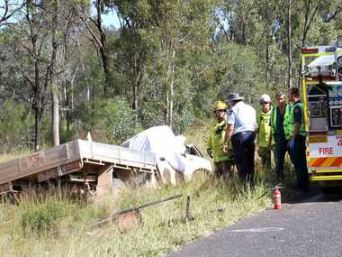SOMBRE SCENE: Emerald worker Mark Anthony Brown, 41, (inset) was killed when his utility crashed into a tree 10km west of Anakie, on the Capricorn Hwy.