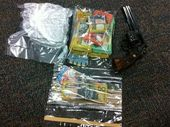 The handgun, drugs and cash uncovered in police raids in Toowoomba and across south-west Queensland.