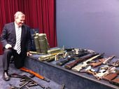 Police Minister Jack Dempsey with some of the weapons from the gun amnesty.