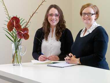 New employee Rachael Dixon (left) and Jacky James in their new office.