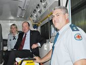Yeppoon Ambulance Officers Michelle Baxter and OIC Jason Thompson show Member for Keppel the layout of the new ambulance.