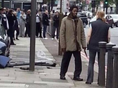 A PASSER-BY has given a shocking first hand account of her encounter with the two men who allegedly murdered a soldier in Woolwich on Wednesday.