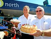 North Real Estate agents Paul Rykse and Geoff Grinham enjoy their World's Biggest Morning Tea.