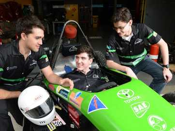 2010 graduate from St Edmund's College Conor Duxbury (right) with Tim Shannon (left) and Harry Copeland (middle) and the car they made at the school to race in university races.