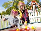 Georgie (left) and Jessica Buckley enjoy the Toowoomba Preparatory School fete.
