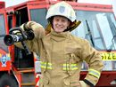 EVA Plessing, a 27-year-old petite blonde, is the first female aviation firefighter in Mackay.