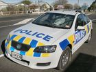 A MAN who smashed a police patrol car windscreen with a dive cylinder appeared in a New Zealand court on Wednesday and asked if he could have his cylinder back.