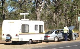 A CAR towing a caravan and a Ford Falcon crashed at the intersection of Old Toogoom Rd and Torbanlea Rd about 10.30am.