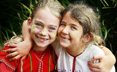 RAISING FUNDS: Dressed in traditional ethnic Burmese Karen dress as part of Rice Day are St Joseph's Primary School Alstonville pupils Molly Hipkins, 7 and Sarah Fivaz, 6, two of the school's pupils raising money for displaced Burmese refugees.