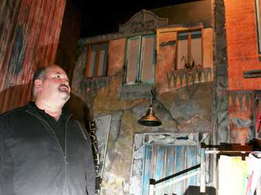 CURTAINS CLOSE: Allan Nagy takes a last look around the set on the Abbey Theatre stage.