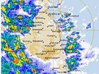 A SEVERE thunderstorm was surrounding south-east Queensland on Wednesday with the weather bureau warning of damaging wind, heavy rainfall and large hailstones.