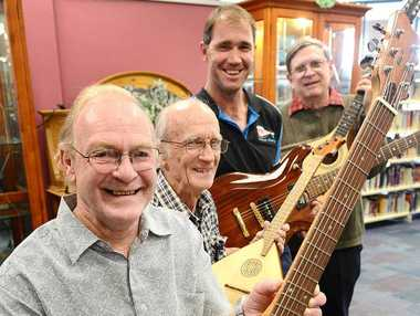 RARE BEAUTIES: Australian Association of Musical Instrument Makers members Ray Mole, Reg Cooke, Ross Wohling and Rob Lowes have an instrument display at the Ipswich Library.