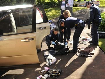 Police investigate stolen car loaded with stolen property dumped in driveway at Fletcher St.