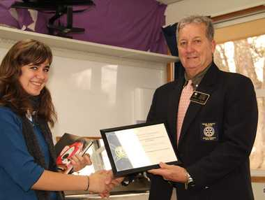 Jessica Swanepoel accepts the charter certificate from District Govenor Lindsay Ford.
