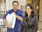 "CHARLES Saatchi denies photos of him repeatedly placing his hands around his wife Nigella Lawson's neck were evidence of anything more than a ""playful tiff""."