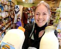 CREAM OF THE CROP: Owner of Poppi's Pantry Erin Talbot with some of the Scenic Rim 4Real milk the store is selling.