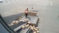 Video of this baggage handler carelessly throwing boxes onto a conveyor belt has gone viral.