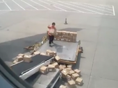 A CARELESS baggage handler has become the latest to earn internet notoriety after video of him clumsily throwing boxes onto a conveyor belt was uploaded.