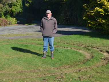 Alan Mason stands in the middle of the latest damage caused by night-time drives on to the grass.