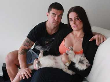 Tahnee Chapman's kitten, Louis Vuitton was mauled by two dogs outside her Kawana Island unit. She is pictured with her partner, Shannon Friedrich.