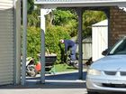 NEIGHBOURS in a quiet Marcoola street watched in disbelief as police swooped on a shed in a $100,000 drug bust.