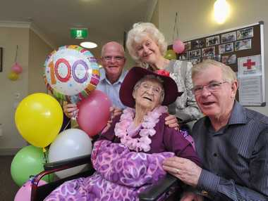 Fairhaven resident Jean MacGregor-Wilson turns 100. Pictured with children (L) Robert Maisey, Edith Hoskins and Jamie MacGregor. Photo: Alistair Brightman / Fraser Coast Chronicle