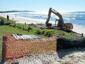 DIG IT: The excavator at work on Seven Mile Beach at Lennox Head this week.