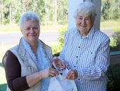 KNOCK KNOCK: Former veteran door knocker Marjorie Peach (right) donates to Blue Care Door Knock Appeal assistant co-ordinator Anne James. The Blue Care Door Knock appeal will be held between July 20 and August 2.