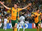 JOSH Kennedy headed home a perfect Marco Bresciano cross to send the Socceroos to their third consecutive World Cup.
