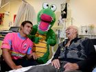 Ben Marshall, Alleygator, at the Tweed hospital with patient Frank Coombe.