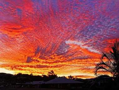 SIMPLY STUNNING: Malcolm Wells (inset) has shared this stunning sunset with The Bulletin.