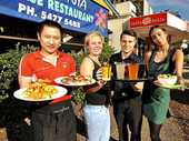 Jin Sheng Ye from Bauhina Chinese Restaurant, Elise Barry from Cafe Envy, Luke Villano from Fasta Pasta and Paula Mirar from Cafe Envy display the global restaurant choices on Brisbane Rd at Mooloolaba.