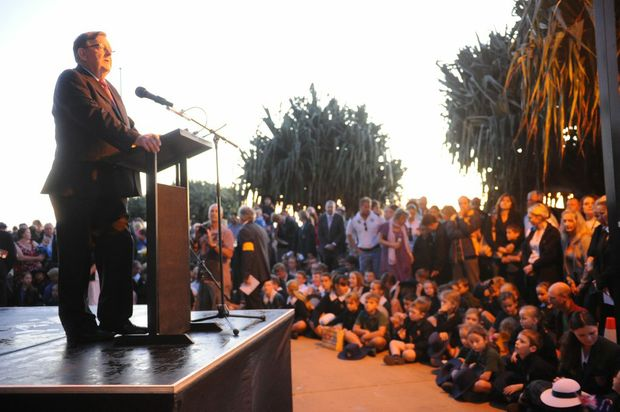 ANZAC DAY: Member for Hinkler Paul Neville addressing the large crowd at the Bargara Dawn Service. Photo: Mike Knott / NewsMail