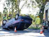 A BLUE Hyundai Excel flipped on to its roof after a two-vehicle incident at Willowbank that also led to a complaint of wilful damage in the aftermath.