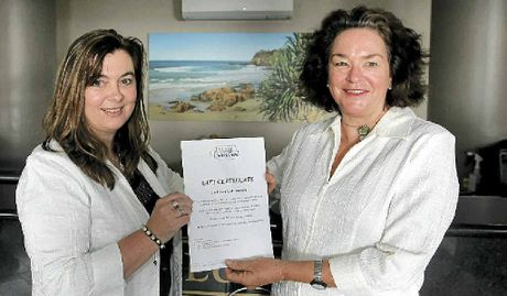 PRIZES GALORE: Clubb Coolum's Denise Holvey presents Allyson Brace with an accommodation prize to auction at the Gala Auction Night on Friday, July 19.