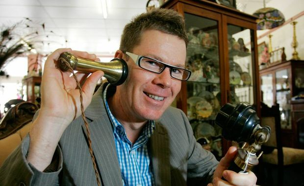 Chris Lawson from Friends of the Rockhampton Art Gallery pictured here with a Candlestick telephone dating from around 1910 at the House of Treasures on William Street calling on people to bring their antiques for the upcoming appraisal day. Photo: Chris Ison / The Morning Bulletin