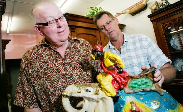 Rob Hughes, President of the Friends of Rockhampton Art Gallery and Jim Ellrott from the House of Treasures on William Street check out an elephant figurine dating from the 1920s. Mr Hughes is calling on people to bring their antiques for the upcoming appraisal day at the Art Gallery. Photo: Chris Ison / The Morning Bulletin