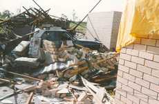 The remains of John and Lexly Black's garage and lounge. A wedding photo and crystal vase were found untouched under a pile of bricks, but some items such as roller doors, ceiling fans and a mattress were never seen again.
