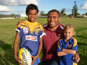 SOUTH Burnett youngsters buzz with excitement as they meet their football hero, Petero Civoniceva during his visit to the region.