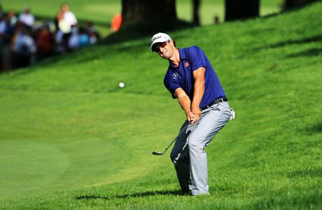 Adam Scott of Australia chips to the 13th green during the final round of the 95th PGA Championship