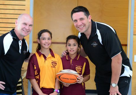 Alfie Langer and Steve Price with Park Avenue State School captain Emily Grey and vice-captain Hannah Russell.