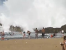 Enclosed beach hit by massive wave