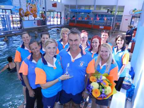 Elders Swim Centre owners Penny and Marcus Elder with their dedicated staff members celebrate after winning the Queensland AUSTSWIM Swim centre of the Year award.