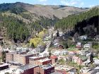 "ONCE one of the ""shootin'est"" places in America's west, Deadwood in South Dakota has a population today of just 1280, yet more than 80 gambling casinos."