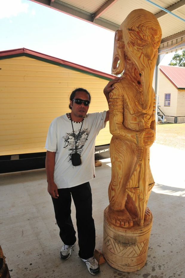 The fishing god solomon island carver norman palmer from for Solomons island fishing report