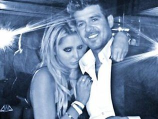 Robin Thicke with a blonde on his arm caught out by a mirror ...