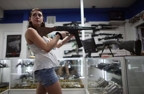 A woman browses for guns at the National Armory gun store in Pompano Beach, Florida